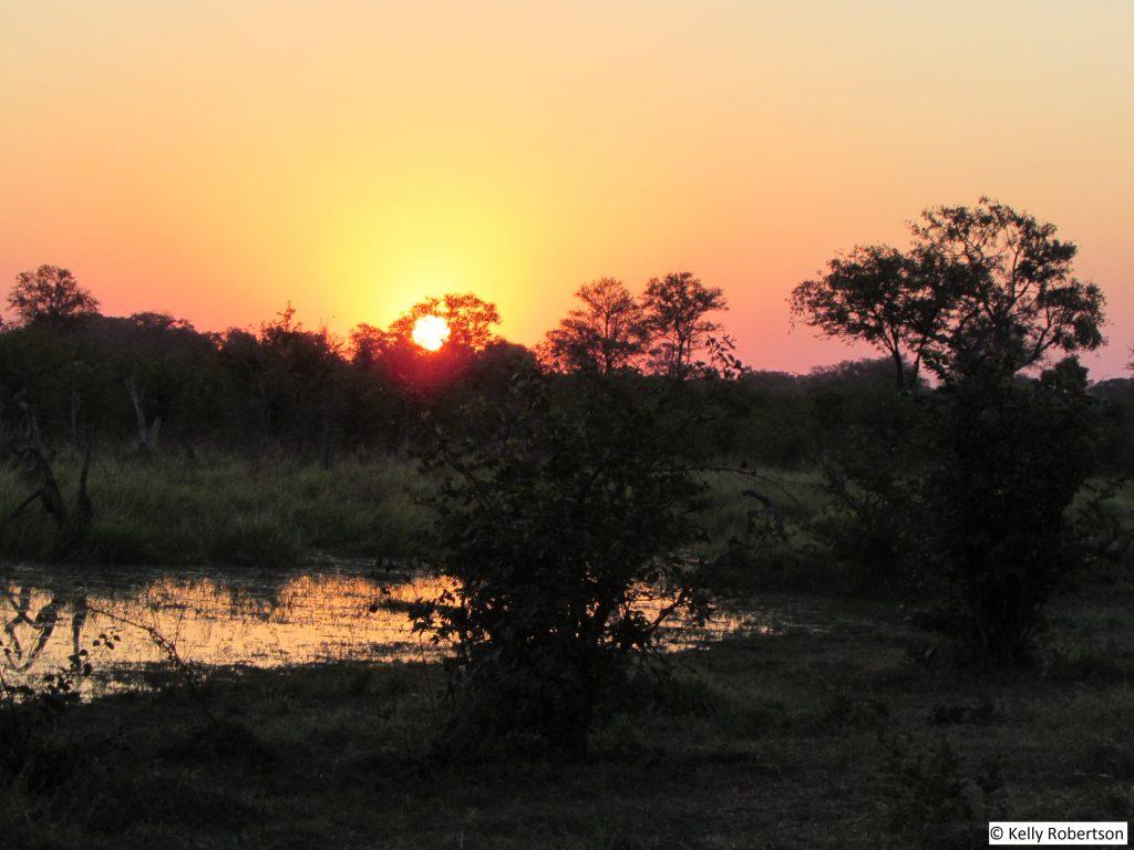 Sunset over the Okavango Delta channel at Dizhana Camp